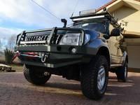 Передний бампер для Toyota PRADO LC90 и LC95 с монтажной плитой под лебедку без кенгурятника (9712)