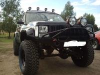 Передний бампер для Jeep Cherokee XJ (1984-2001) с кенгурятником (9648)